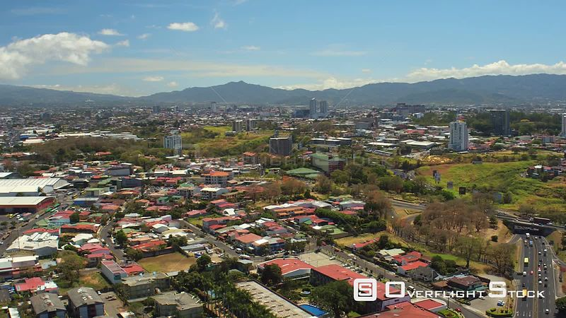 Costa Rica Flying over Robledal area panning with cityscape views