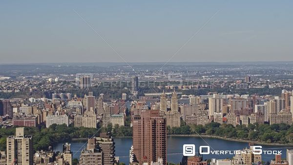 NYC New York Ascending panning cityscape of Upper East & West Sides with Central Park reservoir view