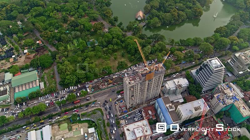 Thailand Bangkok Aerial Panning around Lumphini Park to construction cityscape view