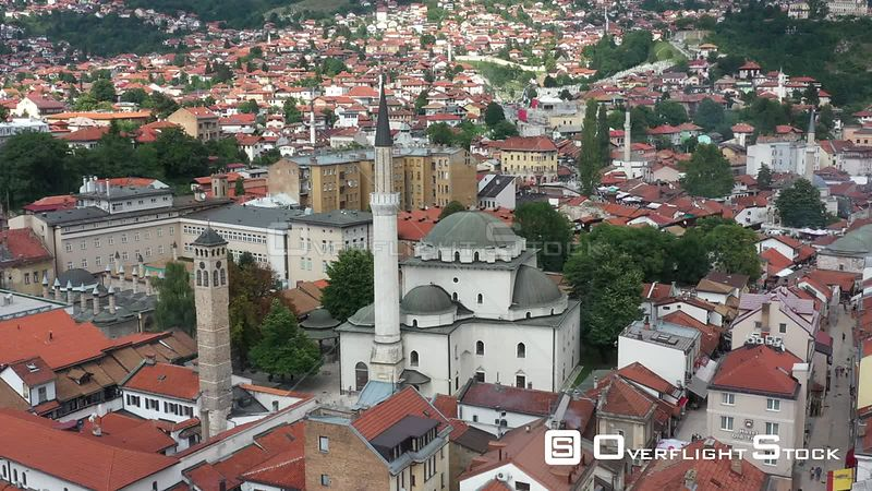 Drone shot Old watch tower and Gazi Husrev Baymosque from Ottoman period in the old part of Sarajevo Called  Bascarsija , Sar...