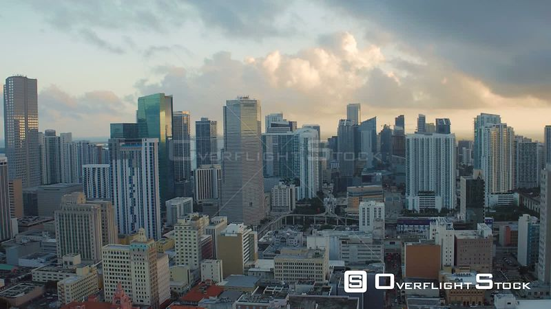 Miami Florida Flying over downtown panning with cityscape views at sunset.