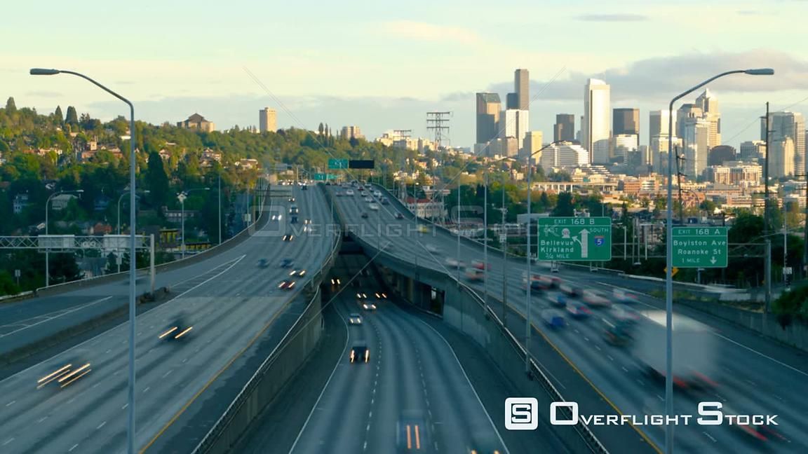 Seattle Washington State USA Interstate 5 Southbound facing traffic time lapse during sunset with Seattle cityscape in backgr...