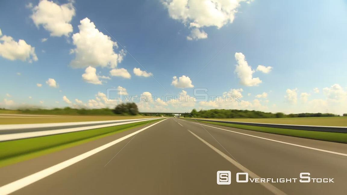Scenic highway driving time lapse clip in France.