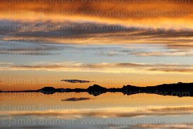 Sunset reflected on surface of Salar de Uyuni in rainy season, Bolivia