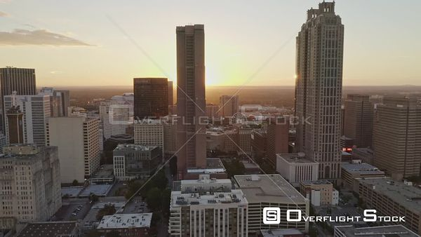 Atlanta Flying into and through downtown cityscape in reverse looking into sunset views