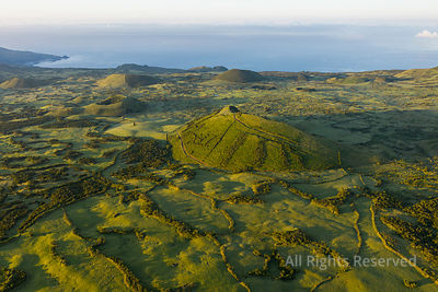 Aerial Image of Typical Green Volcanic Caldera Crater Landscape With Volcano Cones of Planalto Da Achada Central Plateau of I...
