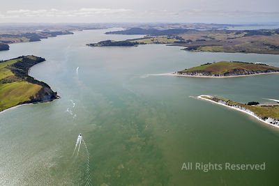Aerial View on Kaipara Harbour With a Motorboat on  Clear Water in Northland, New Zealand. the Landscape Shows Some Coastline...