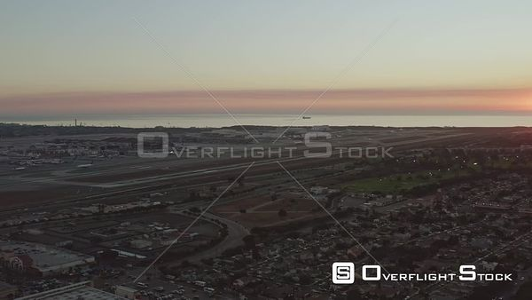 Los Angeles Late sunset airport cityscape panoramic with landing and ocean views