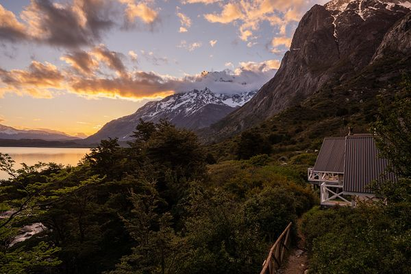 Wooden Eco tourist lodge overlooking lake, Torres del Paine National Park, Last Hope Province, Magallanes Region, Chile, Sout...