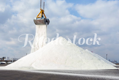 Bulk Road Salt is Poured onto a Large Pile