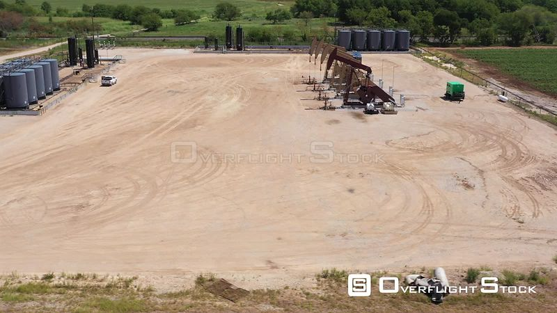 Pumps and tanks at an oil production site, Brazos County, Texas, USA