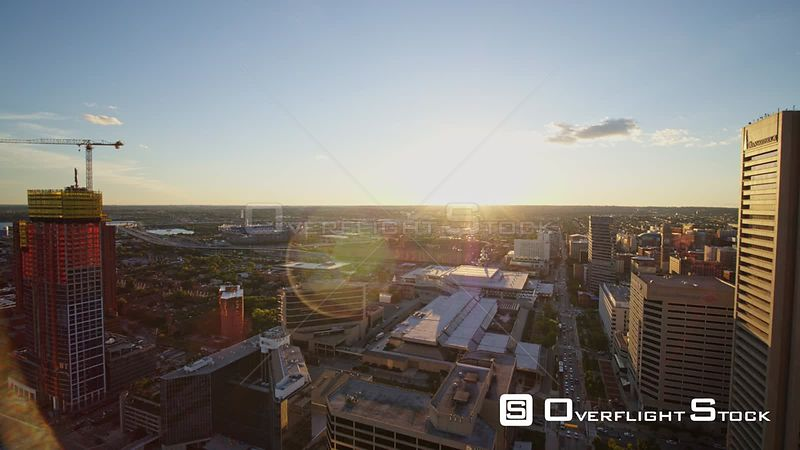 Baltimore Maryland Aerial Vertical riverfront cityscape looking into sunset moving backwards