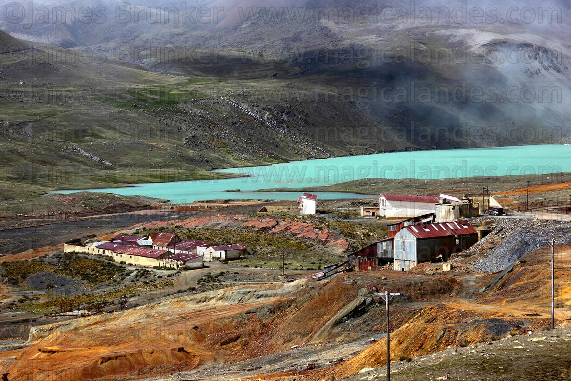 View of Milluni mine on shore of Lake Jankho Khota, Cordillera Real, Bolivia