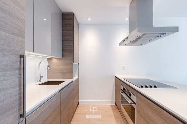 Modern kitchen with wood in a new condo in downtown Montreal
