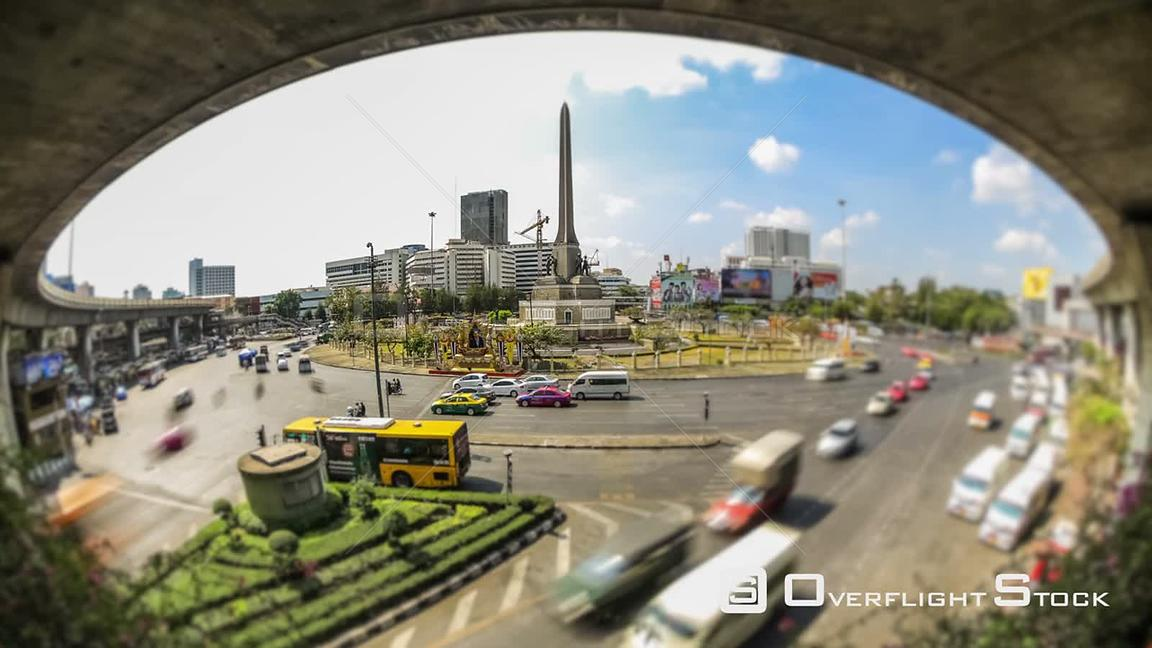 City traffic time lapse of Victory Monument roundabout in Bangkok Thailand
