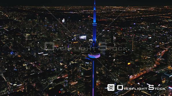 Toronto Ontario Panning birdseye cityscape at night with CN Tower then descending