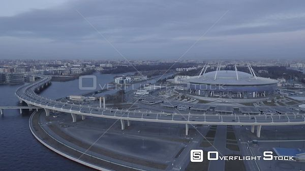 Fly Backward from Zenit Arena Stadium at Sunset. Saint Petersburg Russia Drone Video View