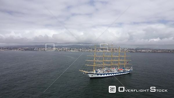 Aerial tracking over Royal Clipper at Cascais coast, on a  partly sunny day, in Lisbon, Portugal - anchored due to the COVID-19