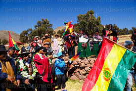 Bolivian president Evo Morales Ayma (centre) waves a Bolivian flag as he leads an International Hike along a section of the Q...