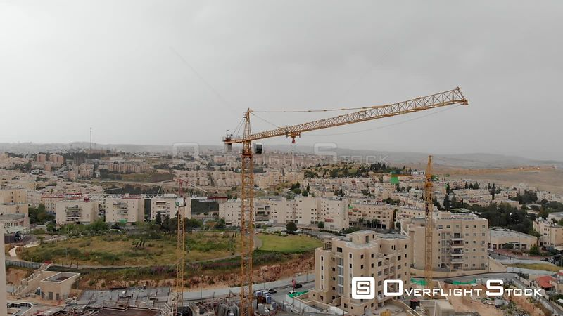 Flying over Cranes and Construction site in Pisgat Zeev North Jerusalem. Israel