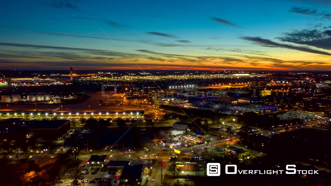 Atlanta Aerial Sunset to night hyperlapse of airport with airplane and car traffic