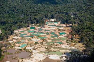 Potaro River and Village of Omai. Open Gold Dig Mining.