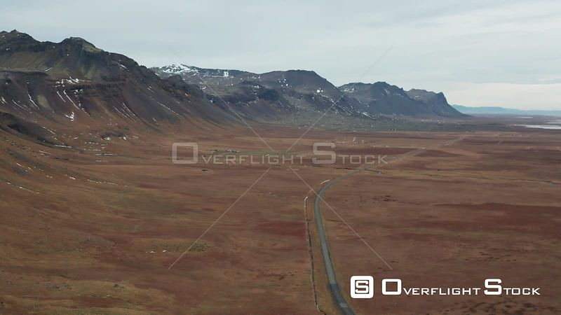 Flying Along a Road Flanked by Mountains in Iceland.