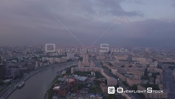 Gloomy Flight Over the Moscow River With Historic Skyscraper. Moscow Russia Drone Video View