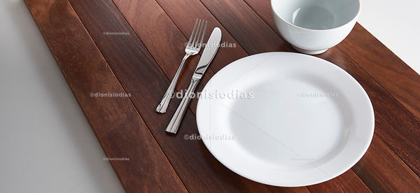 Empty dish on wooden background