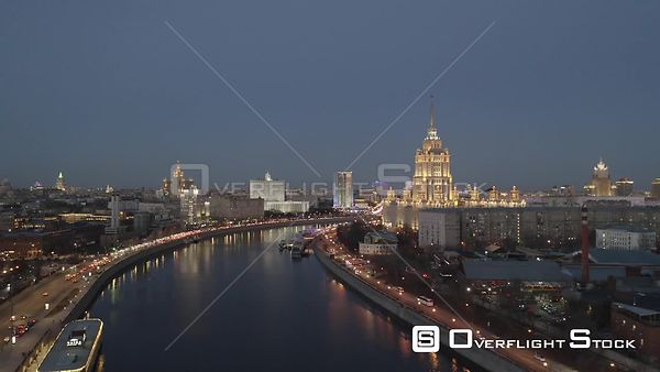 Dusk Ascend Over the River With Moscow Center With Historical Buildings Lighten Up. Moscow Russia Drone Video View