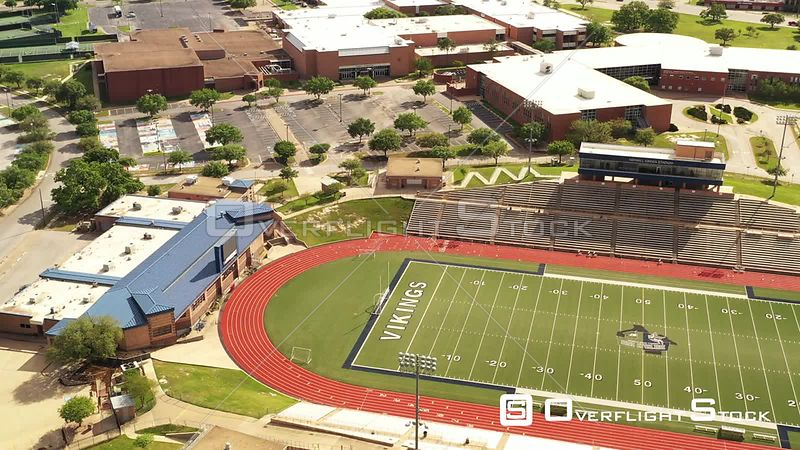Empty High School Football Field, Track, Parking Lot and Buildings, Bryan, Texas, USA