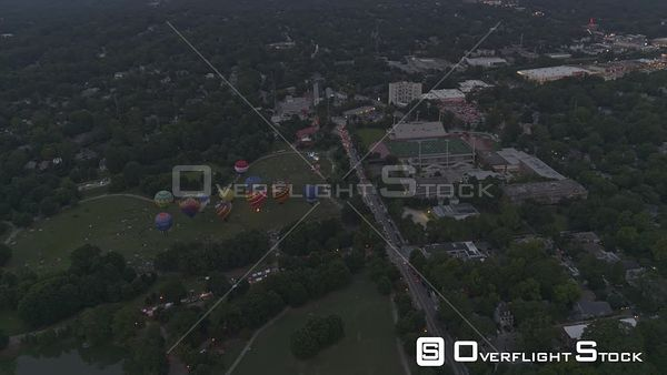Atlanta Traveling birdseye to near vertical views of Piedmont park with hot air balloons at dusk