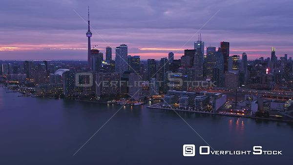 Toronto Ontario Inner Harbour skyline cityscape approach at sunset