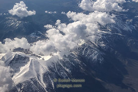 Aerial view of snowy mountains and clouds, Nevada, USA