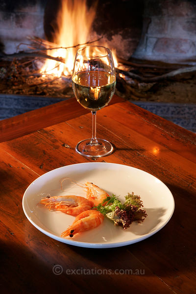 Prawns wine and open fire.