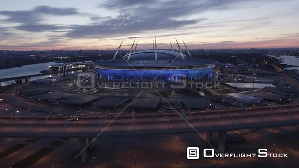 Forward and Descending Flight Towards Football Field Stadium Zenit Arena at Sunrise. Saint Petersburg Russia Drone Video View