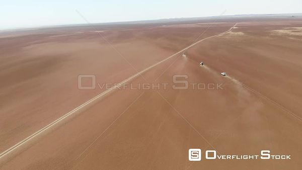 Jeep Convoy on a Sand Desert of Africa Drone Aerial View