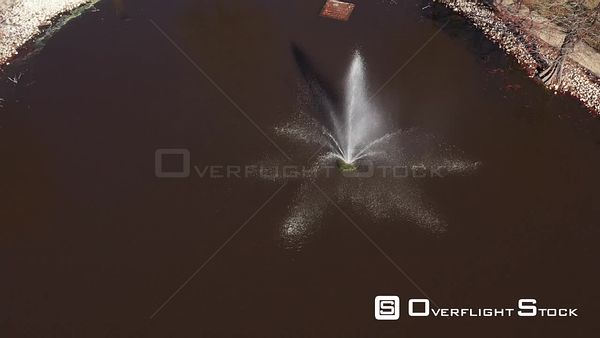Orbiting Around a Fountain with Rainbows and Sunlight Reflections, Bryan, Texas, USA