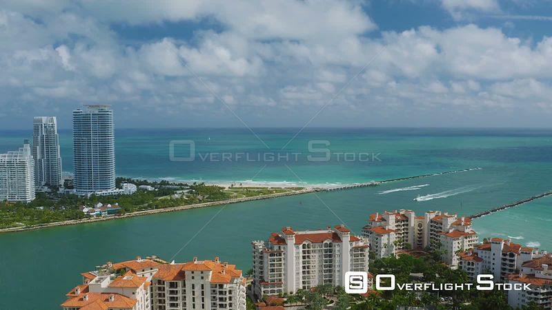 Miami Florida Flying over Fisher Island panning with South Beach and cityscape views.