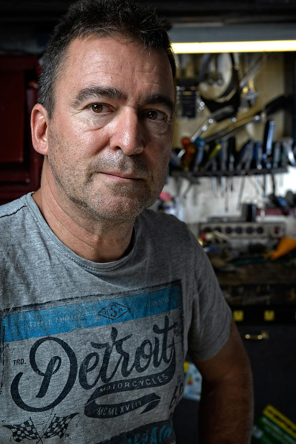 Montreal editorial photographer, location portrait Daniel Honda motorcycle mechanic
