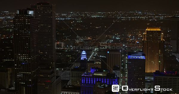 New Orleans Louisiana Aerial Flying around to birdseye, nighttime view of downtown cityscape
