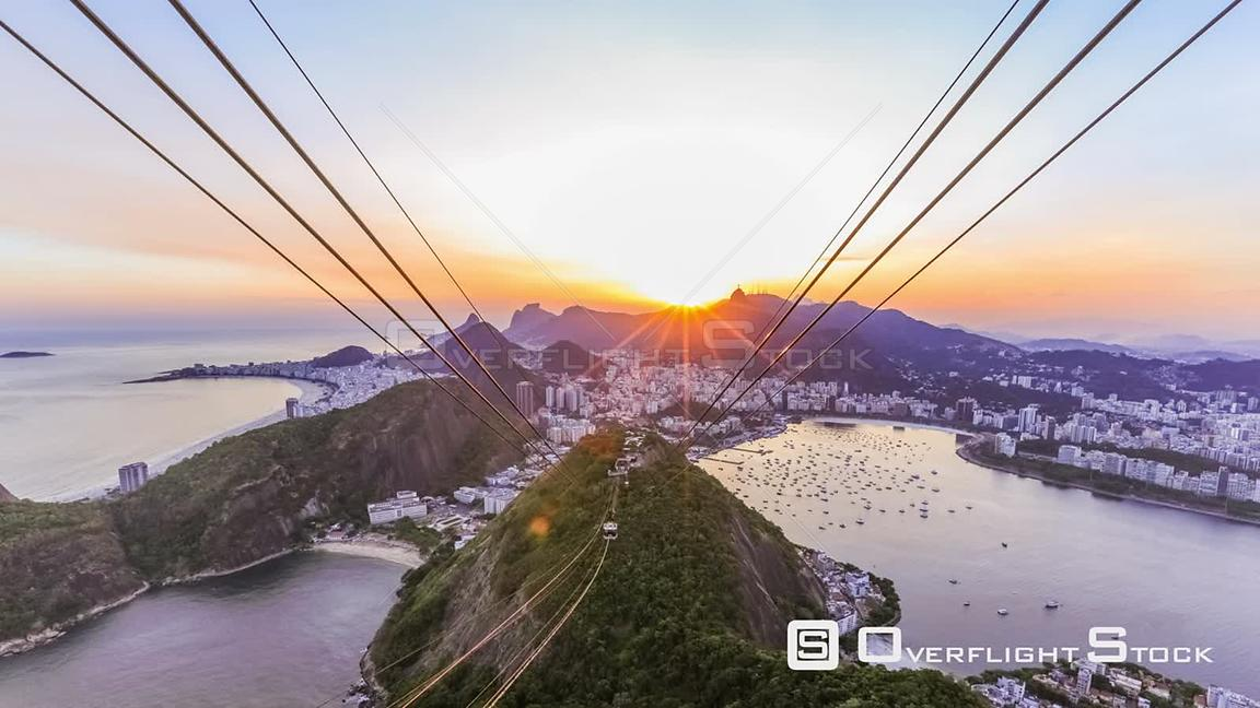 Rio de Janeiro Brazil Rio De Janeiro cityscape time lapse of sunset over Christ The Redeemer from Sugar Loaf Mountain