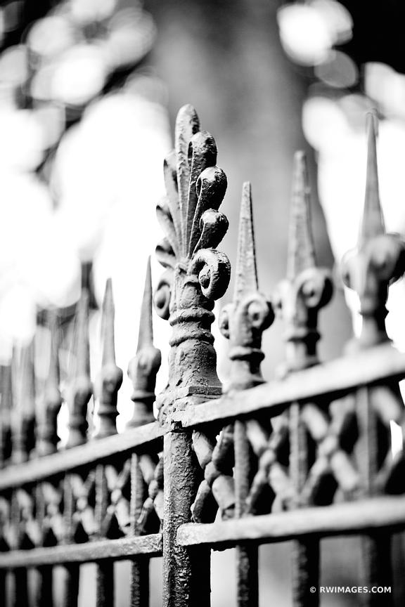 IRON FENCE FRENCH QUARTER NEW ORLEANS LOUISIANA BLACK AND WHITE VERTICAL