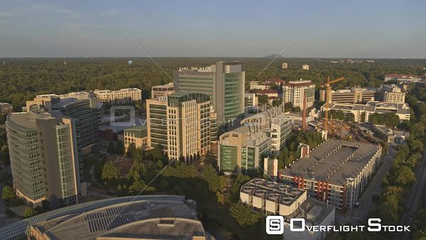 Atlanta Bright panning birdseye overtop CDC and Emory Campus at sunset