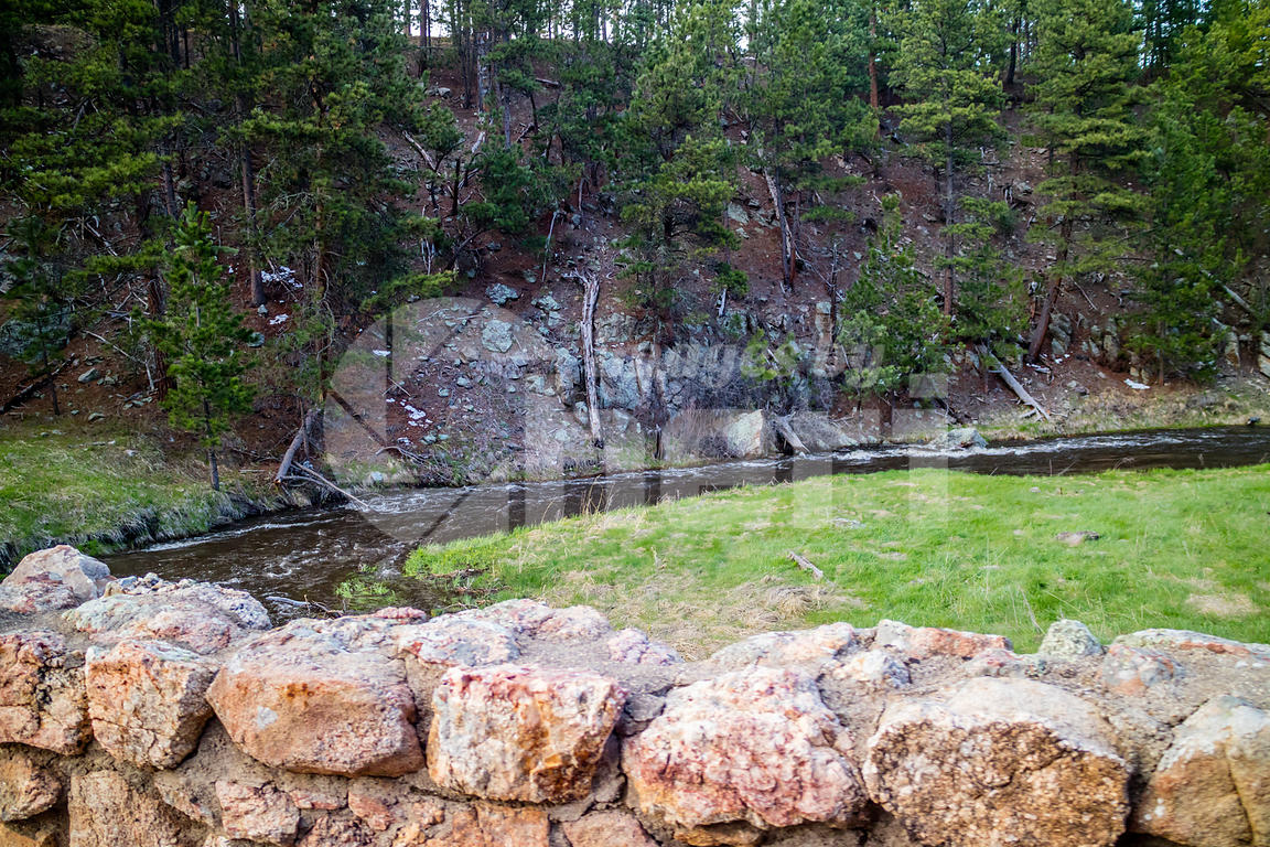 A narrow stream of water in Custer State Park, South Dakota
