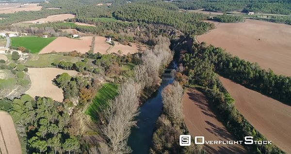 Drone Footage  llobregat river on its way near the village of Balsareny with plowed fields and trees Spain