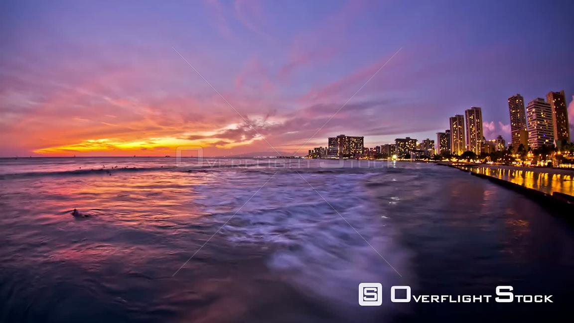 Beach time lapse clip of waves and Waikiki during sunset. Hawaii