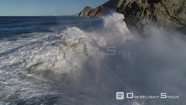 Waves Crashing on a Rugged Rocky Shoreline California Drone Aerial View