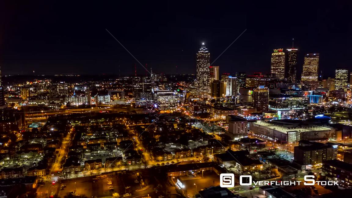 Atlanta Aerial Hyperlapse crossing through downtown with cityscape views at night, toward and away from city center