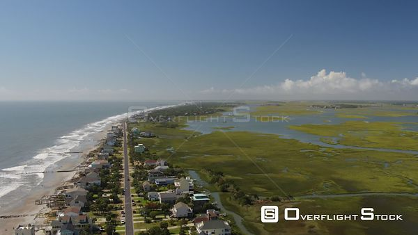 South Carolina Charleston Folly Beach Aerial Flying high to low over Folly Beach neighborhood & water
